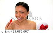 Купить «Happy gorgeous woman holding a bowl with strawberries», видеоролик № 29685667, снято 14 июня 2013 г. (c) Wavebreak Media / Фотобанк Лори