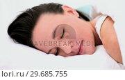 Купить «Calm beautiful woman lying in her bed under the cover while sleeping », видеоролик № 29685755, снято 18 июля 2013 г. (c) Wavebreak Media / Фотобанк Лори