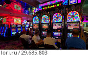 Купить «People are playing slot machines at MGM casino», видеоролик № 29685803, снято 10 сентября 2018 г. (c) Антон Гвоздиков / Фотобанк Лори