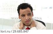 Купить «Frowning handsome businessman having neck pain», видеоролик № 29685847, снято 8 августа 2013 г. (c) Wavebreak Media / Фотобанк Лори