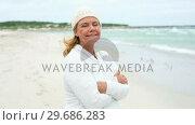 Купить «Retired woman on the beach looking out to sea», видеоролик № 29686283, снято 11 октября 2013 г. (c) Wavebreak Media / Фотобанк Лори