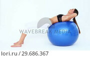 Купить «Fit woman doing sit ups on blue exercise ball», видеоролик № 29686367, снято 15 октября 2013 г. (c) Wavebreak Media / Фотобанк Лори
