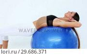 Купить «Fit model doing sit ups on exercise ball», видеоролик № 29686371, снято 15 октября 2013 г. (c) Wavebreak Media / Фотобанк Лори