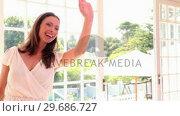 Купить «Pretty woman entering a restaurant and waving», видеоролик № 29686727, снято 12 декабря 2013 г. (c) Wavebreak Media / Фотобанк Лори