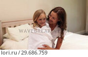 Купить «Mother sitting with her little girl wrapped up in a towel», видеоролик № 29686759, снято 13 декабря 2013 г. (c) Wavebreak Media / Фотобанк Лори