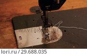 Купить «Close-up of sewing machine», видеоролик № 29688035, снято 1 июля 2016 г. (c) Wavebreak Media / Фотобанк Лори