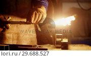 Купить «Welder holding welding torch», видеоролик № 29688527, снято 11 июня 2016 г. (c) Wavebreak Media / Фотобанк Лори