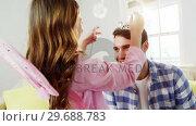 Купить «Girl dressed up in a fairy costume placing tiara on fathers head», видеоролик № 29688783, снято 28 июня 2016 г. (c) Wavebreak Media / Фотобанк Лори