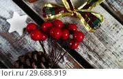 Купить «Christmas cookies, pine cone, cookie cutter, cherries and cup cake with christmas decoration», видеоролик № 29688919, снято 30 августа 2016 г. (c) Wavebreak Media / Фотобанк Лори