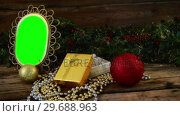 Купить «Christmas decoration and ornaments on wooden plank», видеоролик № 29688963, снято 30 августа 2016 г. (c) Wavebreak Media / Фотобанк Лори