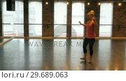 Купить «Woman practicing a tap dance», видеоролик № 29689063, снято 1 сентября 2016 г. (c) Wavebreak Media / Фотобанк Лори
