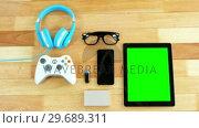 Купить «Digital tablet, mobile phone, usb flash drive, joystick, headphones and spectacles», видеоролик № 29689311, снято 8 июня 2016 г. (c) Wavebreak Media / Фотобанк Лори