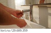 Купить «Man washing his hands in bathroom sink», видеоролик № 29689359, снято 26 августа 2016 г. (c) Wavebreak Media / Фотобанк Лори