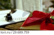 Купить «Close-up of gift box, diary, ink bottle and quill», видеоролик № 29689759, снято 6 июня 2016 г. (c) Wavebreak Media / Фотобанк Лори