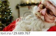 Купить «Santa claus relaxing and sleeping», видеоролик № 29689767, снято 6 июня 2016 г. (c) Wavebreak Media / Фотобанк Лори