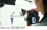 Купить «Male model posing for fashion shoot», видеоролик № 29689927, снято 1 сентября 2016 г. (c) Wavebreak Media / Фотобанк Лори