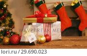 Купить «Wrapped gifts on wooden table», видеоролик № 29690023, снято 31 августа 2016 г. (c) Wavebreak Media / Фотобанк Лори