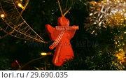 Купить «Decorations on christmas tree», видеоролик № 29690035, снято 31 августа 2016 г. (c) Wavebreak Media / Фотобанк Лори