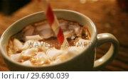 Купить «Cup of coffee with straw on a table», видеоролик № 29690039, снято 31 августа 2016 г. (c) Wavebreak Media / Фотобанк Лори