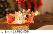 Купить «Christmas gingerbread cookies on wooden table», видеоролик № 29690059, снято 31 августа 2016 г. (c) Wavebreak Media / Фотобанк Лори