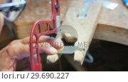 Купить «Craftswoman using hacksaw», видеоролик № 29690227, снято 23 августа 2016 г. (c) Wavebreak Media / Фотобанк Лори
