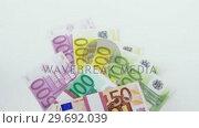 Купить «Bundle of 50, 100, 200 and 500 euro dollar», видеоролик № 29692039, снято 12 августа 2016 г. (c) Wavebreak Media / Фотобанк Лори