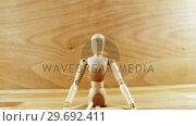 Купить «Figurine performing yoga», видеоролик № 29692411, снято 23 августа 2016 г. (c) Wavebreak Media / Фотобанк Лори