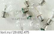 Купить «Close-up of an electric bulbs», видеоролик № 29692475, снято 23 августа 2016 г. (c) Wavebreak Media / Фотобанк Лори
