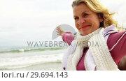 Купить «Beautiful woman enjoying on beach», видеоролик № 29694143, снято 29 сентября 2016 г. (c) Wavebreak Media / Фотобанк Лори
