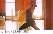 Купить «Woman performing stretching exercise», видеоролик № 29694587, снято 11 сентября 2016 г. (c) Wavebreak Media / Фотобанк Лори