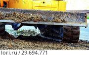 Купить «Excavator moving on soil», видеоролик № 29694771, снято 5 октября 2016 г. (c) Wavebreak Media / Фотобанк Лори