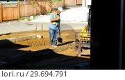 Купить «Engineer leveling ground with shovel», видеоролик № 29694791, снято 5 октября 2016 г. (c) Wavebreak Media / Фотобанк Лори