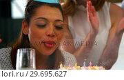 Купить «Business executive celebrating a birth day party in office», видеоролик № 29695627, снято 15 октября 2016 г. (c) Wavebreak Media / Фотобанк Лори