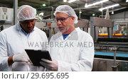 Купить «Workers discussing over digital tablet», видеоролик № 29695695, снято 20 октября 2016 г. (c) Wavebreak Media / Фотобанк Лори