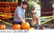 Купить «Man carving a pumpkin to make halloween lantern», видеоролик № 29695907, снято 12 сентября 2016 г. (c) Wavebreak Media / Фотобанк Лори