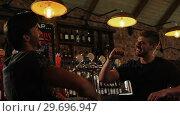 Купить «Two male friends giving high five to each other at counter», видеоролик № 29696947, снято 15 ноября 2016 г. (c) Wavebreak Media / Фотобанк Лори
