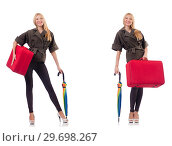 Купить «Young beautiful woman with suitcase and umbrella isolated on whi», фото № 29698267, снято 20 января 2019 г. (c) Elnur / Фотобанк Лори