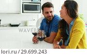 Купить «Couple interacting with each other while having glasses of red wine in the kitchen», видеоролик № 29699243, снято 29 ноября 2016 г. (c) Wavebreak Media / Фотобанк Лори