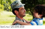 Купить «Army soldier interacting with his son in park», видеоролик № 29699659, снято 10 ноября 2016 г. (c) Wavebreak Media / Фотобанк Лори