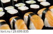 Купить «Various sushi on black background», видеоролик № 29699835, снято 8 декабря 2016 г. (c) Wavebreak Media / Фотобанк Лори