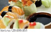 Купить «Various sushi on tray with sauce», видеоролик № 29699851, снято 8 декабря 2016 г. (c) Wavebreak Media / Фотобанк Лори