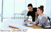Купить «Business executives discussing over laptop», видеоролик № 29699927, снято 23 октября 2016 г. (c) Wavebreak Media / Фотобанк Лори