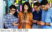 Купить «Executives standing in a row using mobile phone during meeting», видеоролик № 29700139, снято 23 ноября 2016 г. (c) Wavebreak Media / Фотобанк Лори