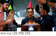 Купить «Happy executives celebrating their colleagues birthday», видеоролик № 29700155, снято 23 ноября 2016 г. (c) Wavebreak Media / Фотобанк Лори