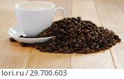 Купить «Cup of coffee with roasted beans», видеоролик № 29700603, снято 6 октября 2016 г. (c) Wavebreak Media / Фотобанк Лори