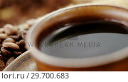 Купить «Coffee with roasted coffee beans», видеоролик № 29700683, снято 6 октября 2016 г. (c) Wavebreak Media / Фотобанк Лори