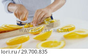 Купить «Mid-section of woman cutting fruits on chopping board», видеоролик № 29700835, снято 19 декабря 2016 г. (c) Wavebreak Media / Фотобанк Лори