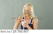 Купить «Woman eating fruit salad in bowl», видеоролик № 29700907, снято 19 декабря 2016 г. (c) Wavebreak Media / Фотобанк Лори