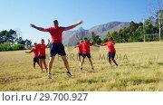 Купить «Trainer training kids in the boot camp», видеоролик № 29700927, снято 16 марта 2017 г. (c) Wavebreak Media / Фотобанк Лори