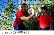 Купить «Trainer giving high five to boy in the boot camp», видеоролик № 29700955, снято 16 марта 2017 г. (c) Wavebreak Media / Фотобанк Лори